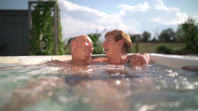 seniors taking on the world, couple enjoying summer day in whirlpool - hot tub stock videos & royalty-free footage