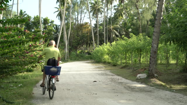 Seniors Taking on the World, seniors biking tropical island vacation