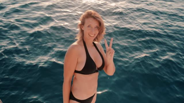 seniors taking on the world - bikini stock videos and b-roll footage