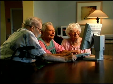 seniors using computer - silver surfer stock videos & royalty-free footage