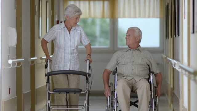 hd: seniors walking down the nursing hall - mobility walker stock videos and b-roll footage