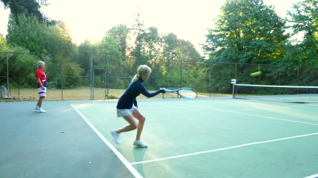 ms seniors warming up for mixed doubles tennis match - patience stock videos & royalty-free footage