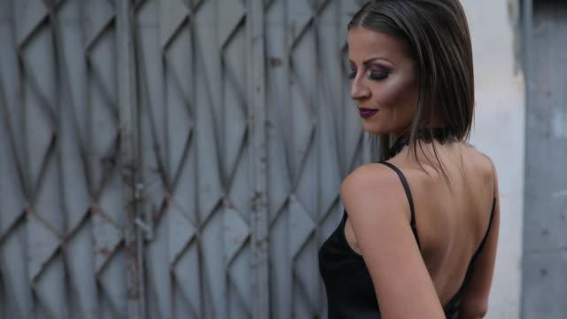 sensual woman in black dress - vestito nero video stock e b–roll