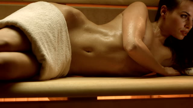 hd dolly: sensual woman relaxing in the sauna - towel stock videos and b-roll footage