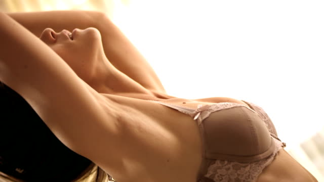 hd slow motion: sensual woman running hands through hair - chest torso stock videos & royalty-free footage