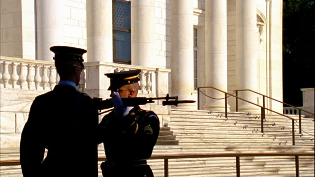 sentinel soldier standing facing sergeant of the guard, officer inspecting sentinel's rifle. - sergeant stock videos & royalty-free footage
