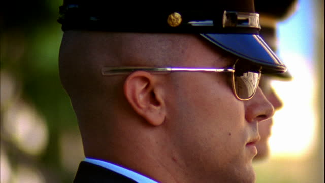 sentinel soldier standing in profile, sergeant of the guard stepping fg frame speaking orders . - sergeant stock videos & royalty-free footage