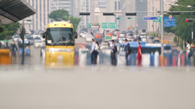seoul citizens crossing the road with heat haze in summer heat wave - summer heat stock videos & royalty-free footage