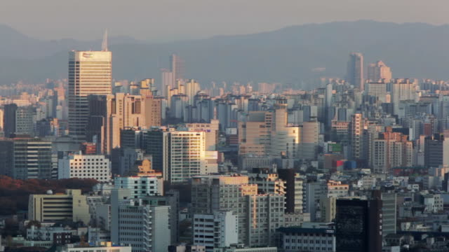 ha, ls, pan seoul city skyline and mountains in distance / seoul, south korea - seoul stock videos & royalty-free footage