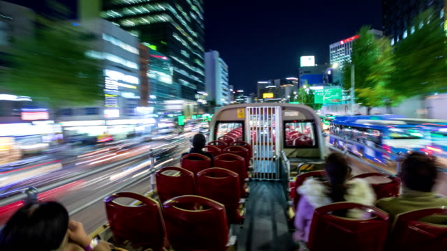 stockvideo's en b-roll-footage met seoul city tour bus on 'downtown palace namsan course' at night / seoul, south korea - dubbeldekker bus