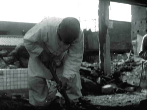 ms seoul civilians rebuilding their town by digging dirt and rubble and stacking bricks / seoul, south korea - korean war stock videos & royalty-free footage