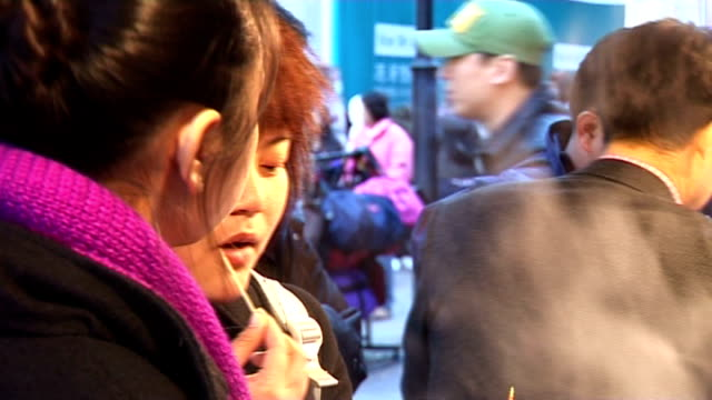 seoul ext south korean people along through shopping street in city centre shots of young south koreans purchasing snack food at street stall teenage... - eaten stock videos & royalty-free footage