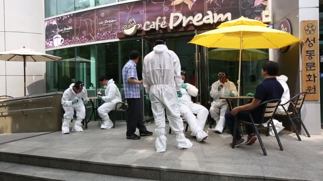 ws seoul metropolitan government workers in protective suits enter the sowol art hall ws seoul metropolitan government workers drink beverages... - coreano video stock e b–roll