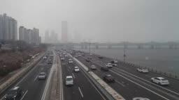 Seoul. South Korea. riverside street car traffic in winter heavy snow.