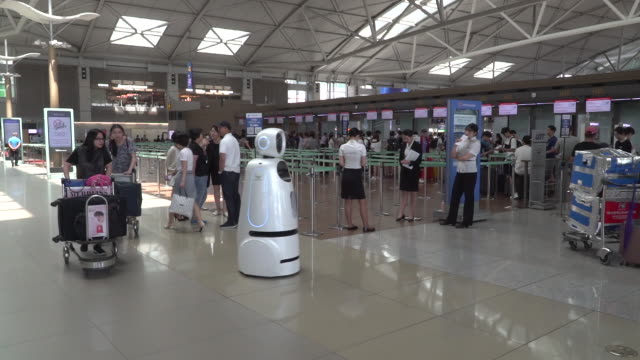seoul's incheon airport has launched fully automated roaming robots to assist passengers the machines called airstar can speak four languages guide... - seoul stock videos & royalty-free footage