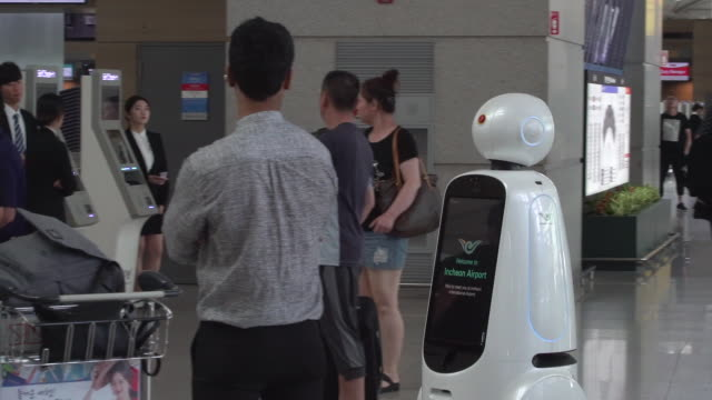 seoul's incheon airport has launched fully automated roaming robots to assist passengers the machines called airstar can speak four languages guide... - flugpassagier stock-videos und b-roll-filmmaterial