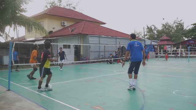 sepak takraw players on tioman island malaysia on sports court by late afternoon on sports court a team game - malaysian culture stock videos & royalty-free footage