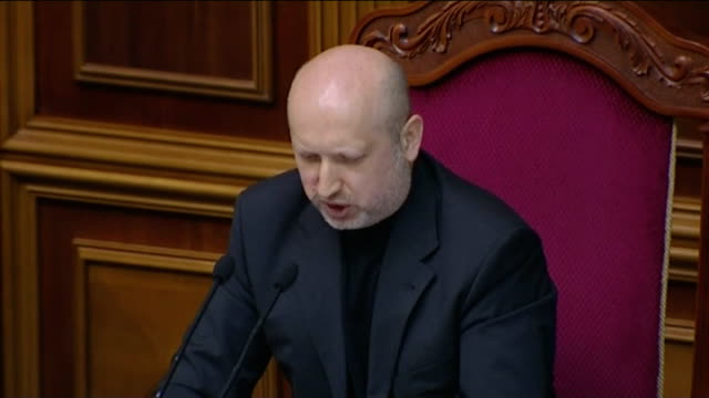 separatism fears grow on ukraine's crimean peninsula t23021414 / 3 int oleksandr turchynov speaking to parliament high angle view parliament chamber - separatism stock videos & royalty-free footage