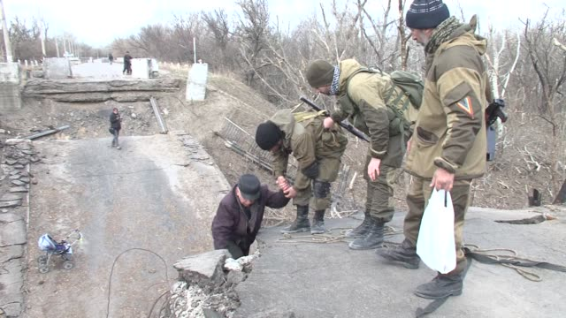 seperatist rebels have installed a precarious makeshift ladder in the frontline village of stanitsa luganska in east ukraine and are helping locals... - resourceful stock videos & royalty-free footage