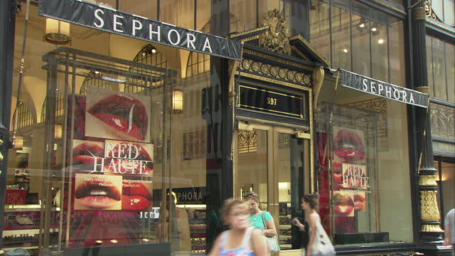 MS Sephora store exterior, Fifth Avenue, pedestrians walking by in foreground / Manhattan, New York City, New York, USA