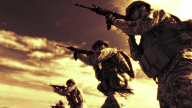 sepia shot of firing line practicing readying their assault rifles. - sepia stock videos & royalty-free footage
