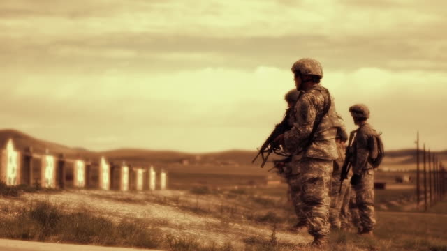sepia shot of soldiers practicing firing weapons - sepia stock videos & royalty-free footage