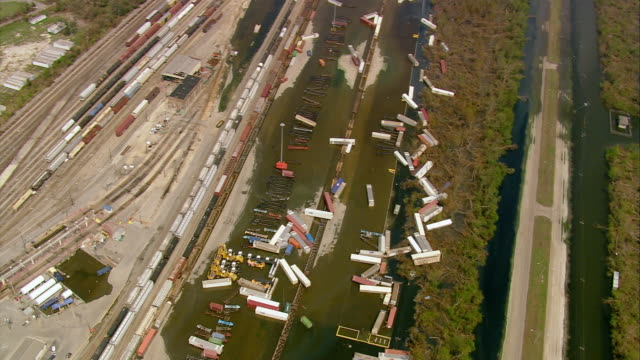 sept 10 2005 aerial scattered containers at rail depot in wake of hurricane katrina / louisiana - 2005 stock videos & royalty-free footage