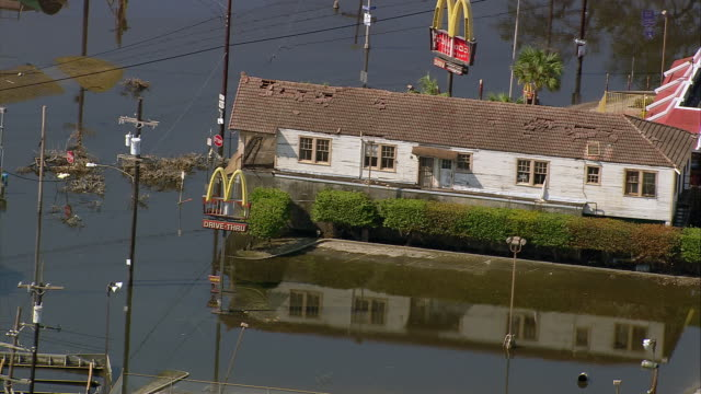 vídeos de stock, filmes e b-roll de sept 11 2005 aerial damaged mcdonald's in floodwater in wake of hurricane katrina / new orleans - 2005