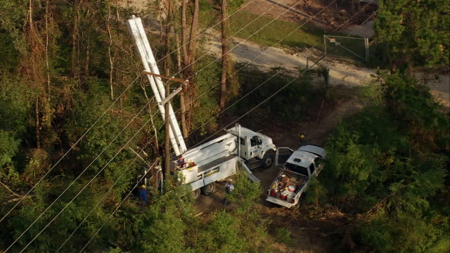 sept 11 2005 aerial electricity repair team working with cherry picker after hurricane / louisiana - cherry picker stock videos & royalty-free footage