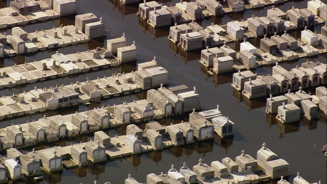 sept 11 2005 aerial flooded cemetery in aftermath of hurricane katrina / new orleans - 2005 stock videos & royalty-free footage