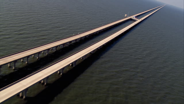 sept 11 2005 aerial lake pontchartrain causeway with very few cars after hurricane / louisiana - londonalight stock videos and b-roll footage