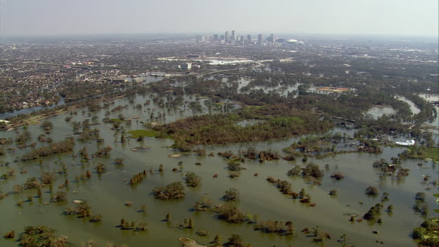 sept 11 2005 aerial over flood toward central business district in wake of hurricane / new orleans - hurricane katrina stock videos and b-roll footage