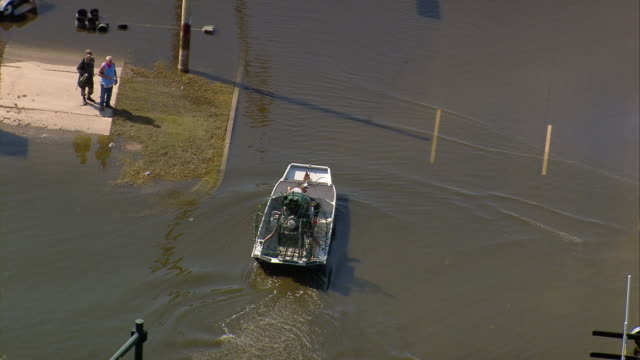sept 11 2005 aerial people in airboats on flooded street in wake of hurricane katrina/ new orleans - 2005 stock videos & royalty-free footage