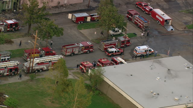 sept 12 2005 aerial convoy of fire trucks leaving fire house / hurricane katrina / new orleans - 2005 stock videos & royalty-free footage