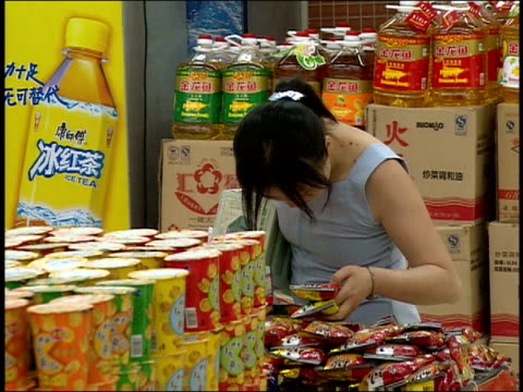 september 1, 2005 montage customers shopping in wumart/ china - 2000s style stock videos & royalty-free footage