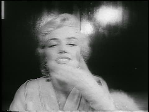 B/W September 10 1954 close up Marilyn Monroe blows kiss smiles at camera / newsreel