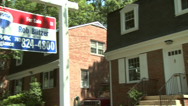 september 10, 2008 remodeled/for sale sign outside house / united states - 不動産の看板点の映像素材/bロール