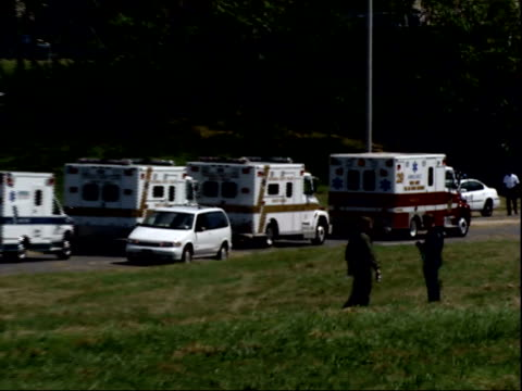 september 11, 2001 a line of ambulances waiting near the pentagon / arlington county, virginia, united states - ministero americano della difesa video stock e b–roll