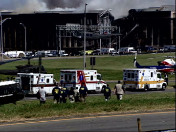 september 11, 2001 fbi making their way toward the pentagon while a helicopter lands nearby / arlington county, virginia, united states - united states department of defense stock videos & royalty-free footage