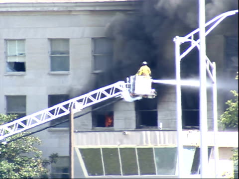 september 11 2001 ws firefighter spraying water from a bucket on a ladder onto the burning pentagon / arlington county virginia united states - united states department of defense stock videos & royalty-free footage