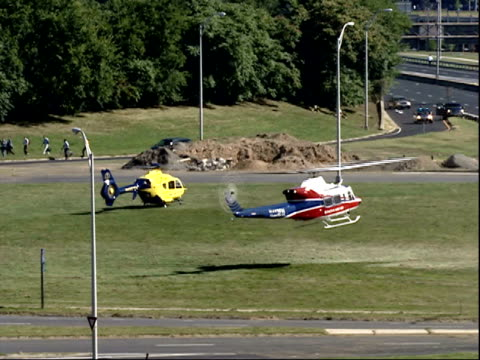 september 11, 2001 helicopter landing in clearing by highway after terrorist attack on pentagon / arlington, virginia, united states - ministero americano della difesa video stock e b–roll