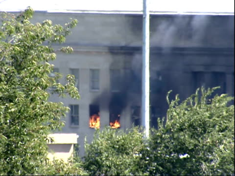 September 11 2001 MONTAGE Smoke and fire billowing from windows of the Pentagon and helicopter flying overhead after the terrorist attack / Arlington...