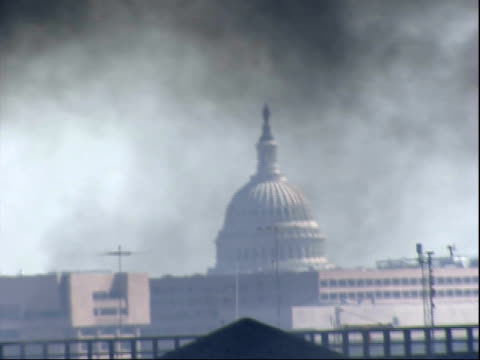 september 11 2001 zo smoke from the burning pentagon blowing across the sky past the capital dome / arlington virginia united states - united states department of defense stock videos & royalty-free footage