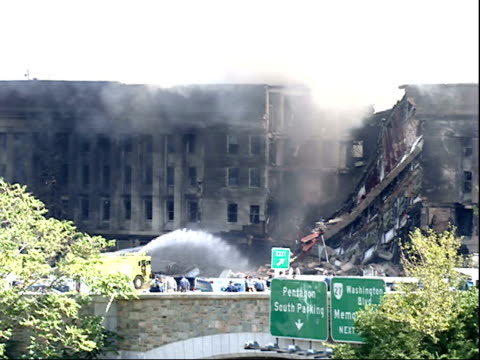 september 11 2001 zi water being sprayed onto the burning portion of the pentagon after the terrorist attack / arlington virginia united states - 2001 bildbanksvideor och videomaterial från bakom kulisserna