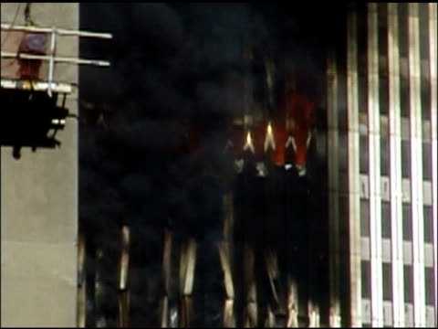 stockvideo's en b-roll-footage met september 11 2001 cu white hot beams of burning tower dark smoke billows out / cuts to view from ground facing west just a few blocks away from twin... - aanslagen op 11 september 2001