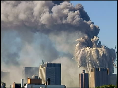 stockvideo's en b-roll-footage met september 11 2001 wide shot wtc towers burn / north tower collapsing / nyc - aanslagen op 11 september 2001