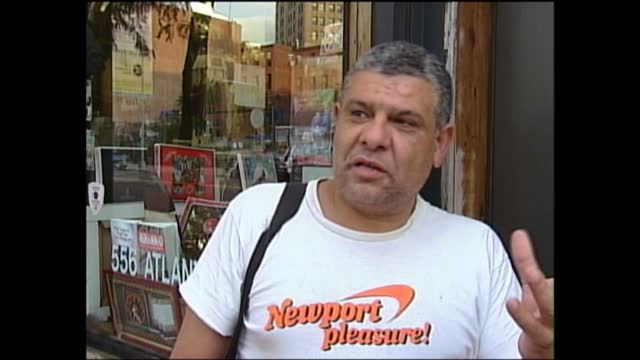 vídeos de stock, filmes e b-roll de september 11th terrorist attacks: muslim response in new york; usa: new york: brooklyn: ext muslim man looking into camera seated in front of... - made in the usa frase americana