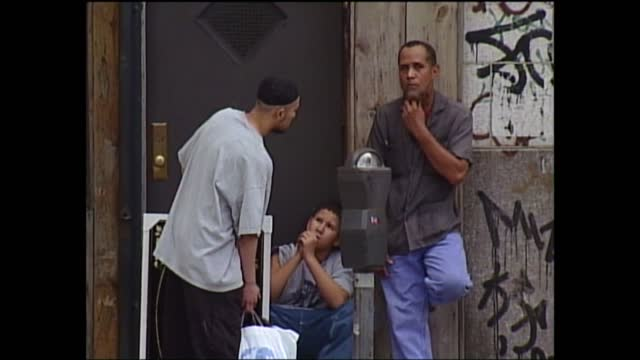 september 11th terrorist attacks: muslim response in new york; usa: new york: brooklyn: ext two arab men stand by entrance to shop lms side arab man... - war in afghanistan: 2001 present stock-videos und b-roll-filmmaterial