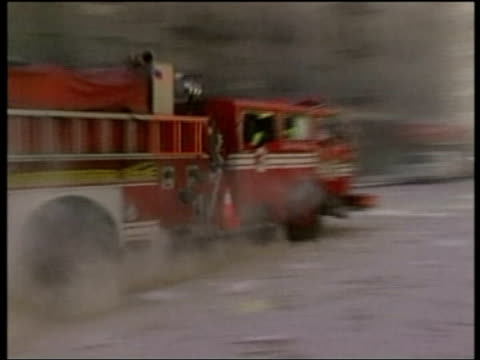 stockvideo's en b-roll-footage met transcripts released pool fire engine along at scene of world trade centre attack emergency workers at scene - aanslagen op 11 september 2001