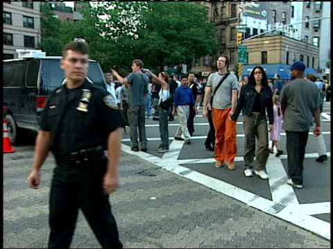 vidéos et rushes de september, 12 2001 police officers directing pedestrians / new york city, new york, united states - 2001